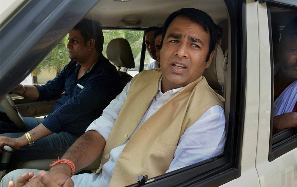Police detain BJP MLA Sangeet Som on his way to attend the party`s Mahapanchayat at Kanth, near Moradabad.