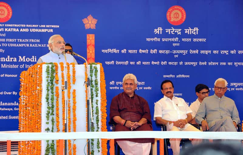 The Prime Minister, Shri Narendra Modi addressing at the dedication ceremony of the newly constructed railway line between Shri Mata Vaishno Devi Katra-Udhampur Section - the first train from Shri Mata Vaishno Devi Katra-Udhampur to the Nation, at Shri Mata Vaishno Devi Katra Railway Station, in Jammu and Kashmir. (Pic Courtesy: PIB)