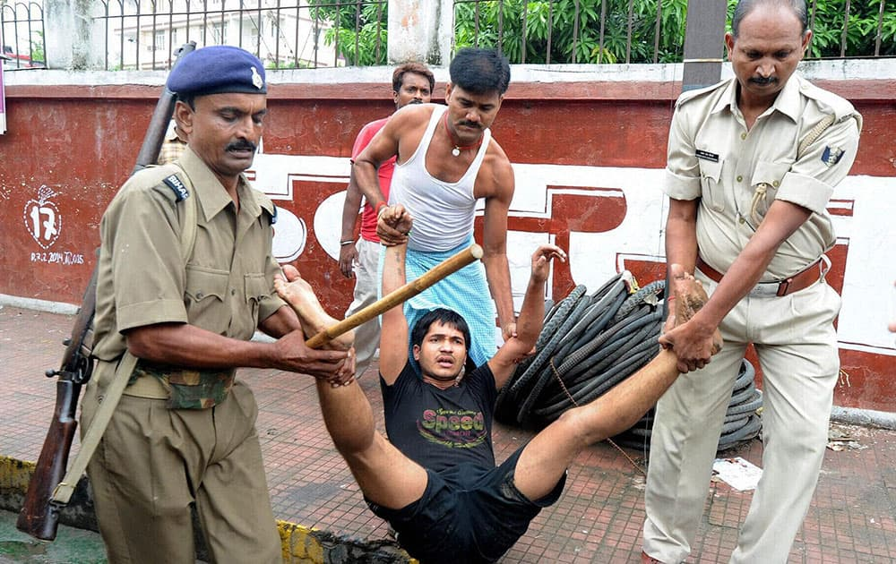 Police re-arresting a youth who ran away from the lock-up in Patna.