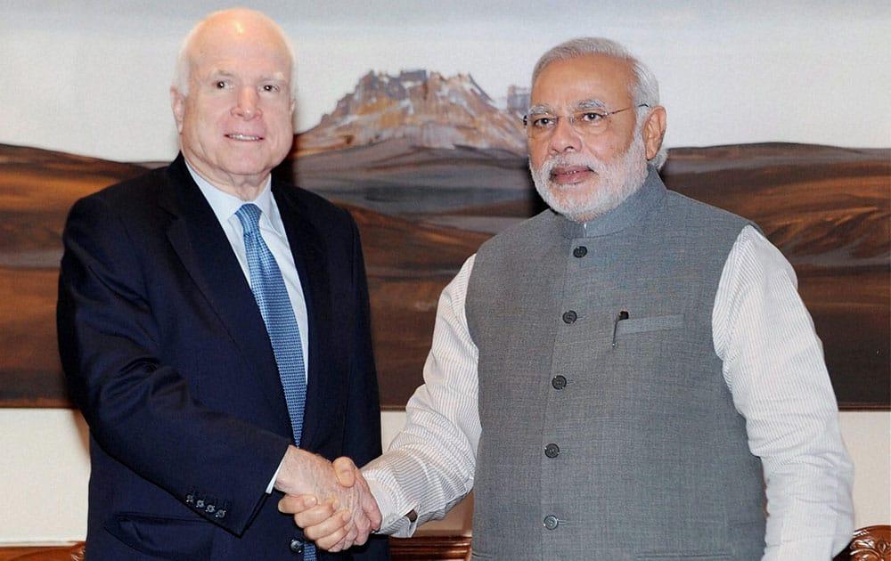 Prime Minister Narendra Modi with US Senator, John McCain at a meeting in New Delhi.
