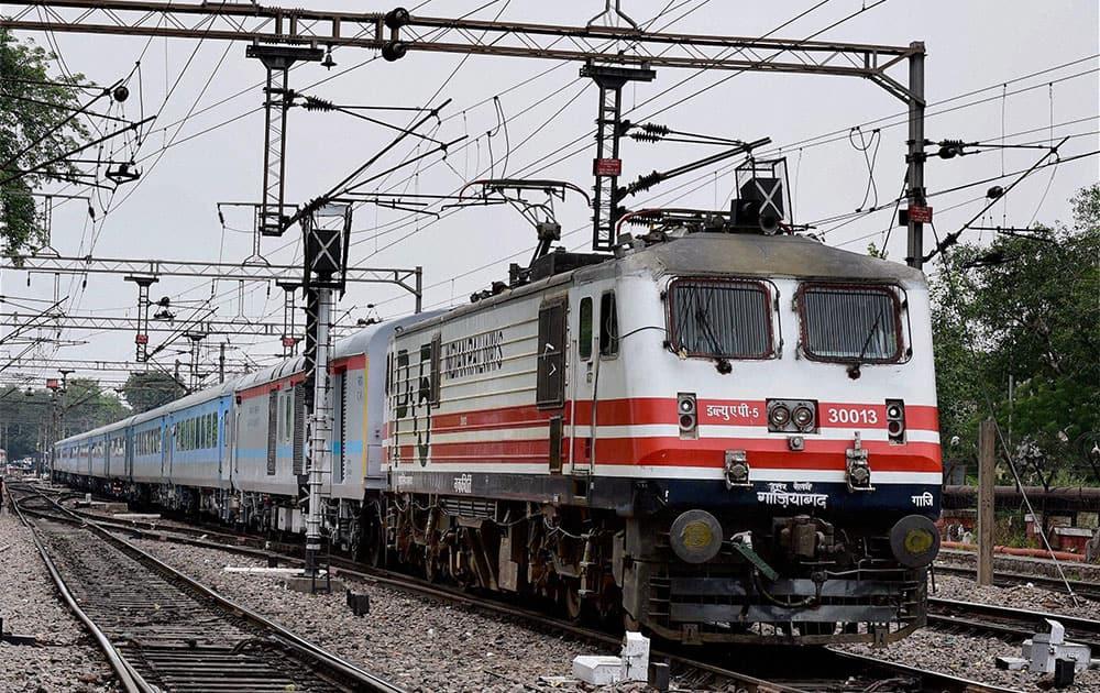 A high speed New Delhi Agra test train leaves New Delhi station.