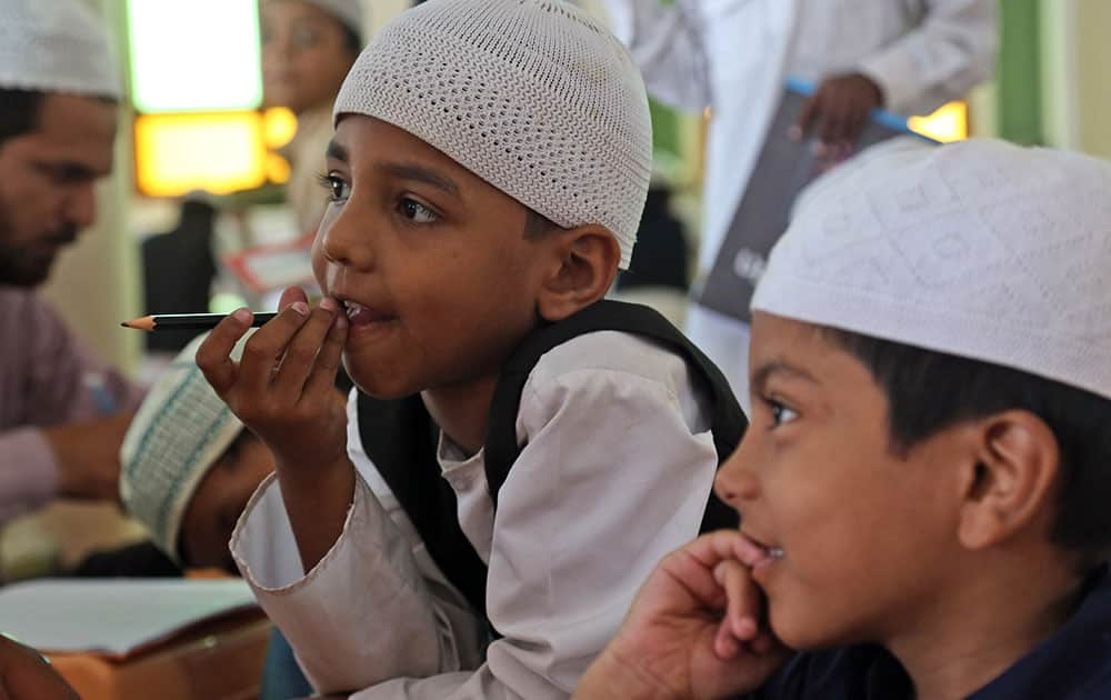 Muslim children attend a class at a madrasa, or religious school, during the holy month of Ramadan in Hyderabad.