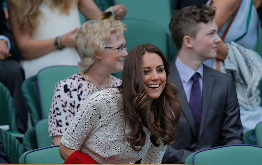 Kate, Duchess of Cambridge takes her seat in the Royal Box on centre court ahead of the women`s singles quarterfinal match between Simona Halep of Romania and Sabine Lisicki of Germany at the All England Lawn Tennis Championships in Wimbledon.