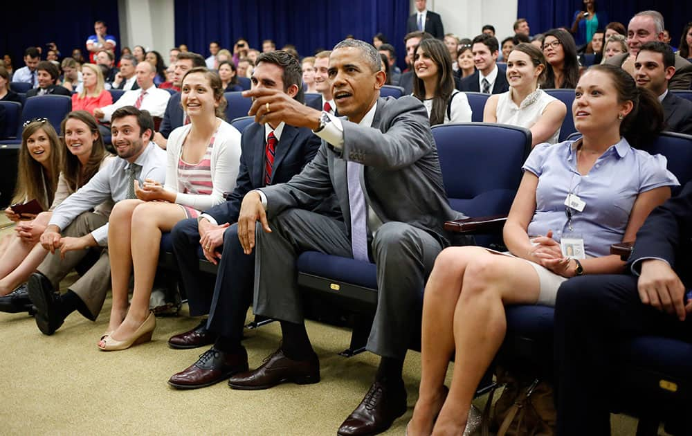 President Barack Obama watches the U.S. vs. Belgium World Cup soccer game at the Eisenhower Executive Office Building with White House staff members on the White House grounds in Washington.