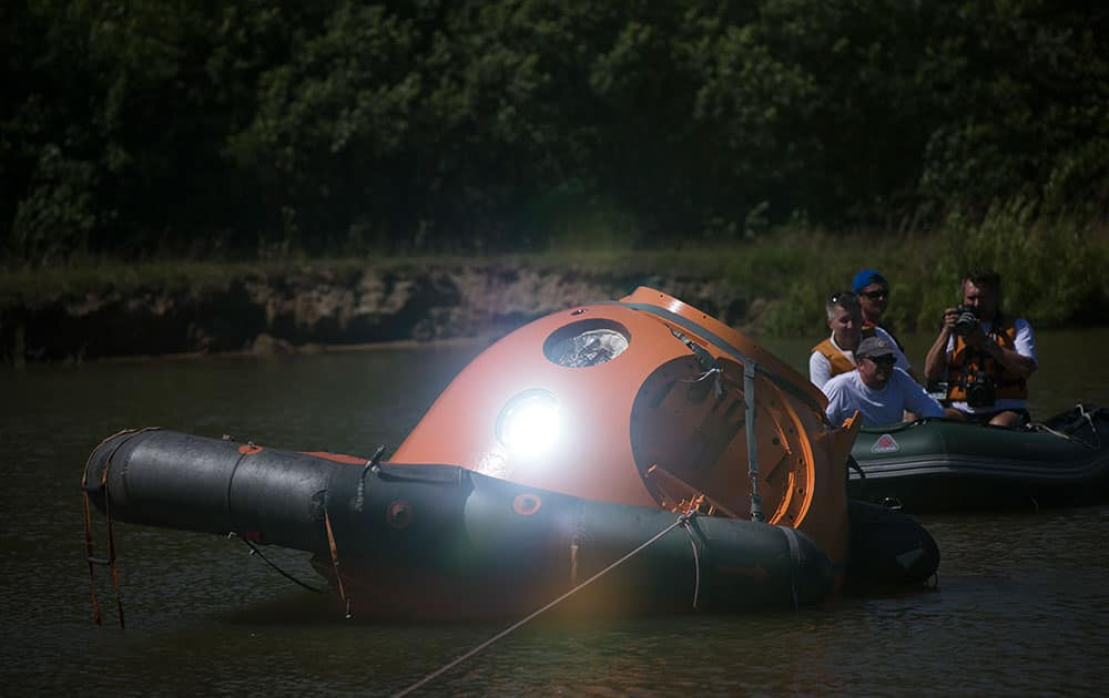 A landing capsule reflects a ray of sunshine during training near Noginsk, 60 km (38 miles) east of Moscow, Russia.