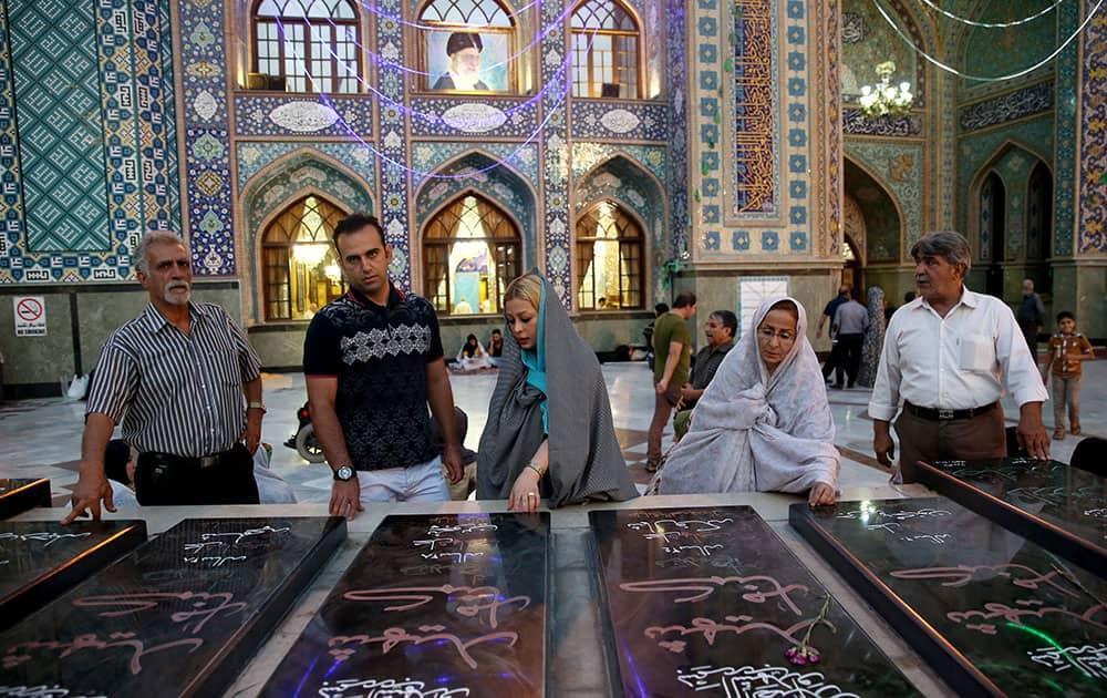 Iranians pray at the shrine of Shiite Saint Saleh during Muslim holy fasting month of Ramadan in northern Tehran, Iran.