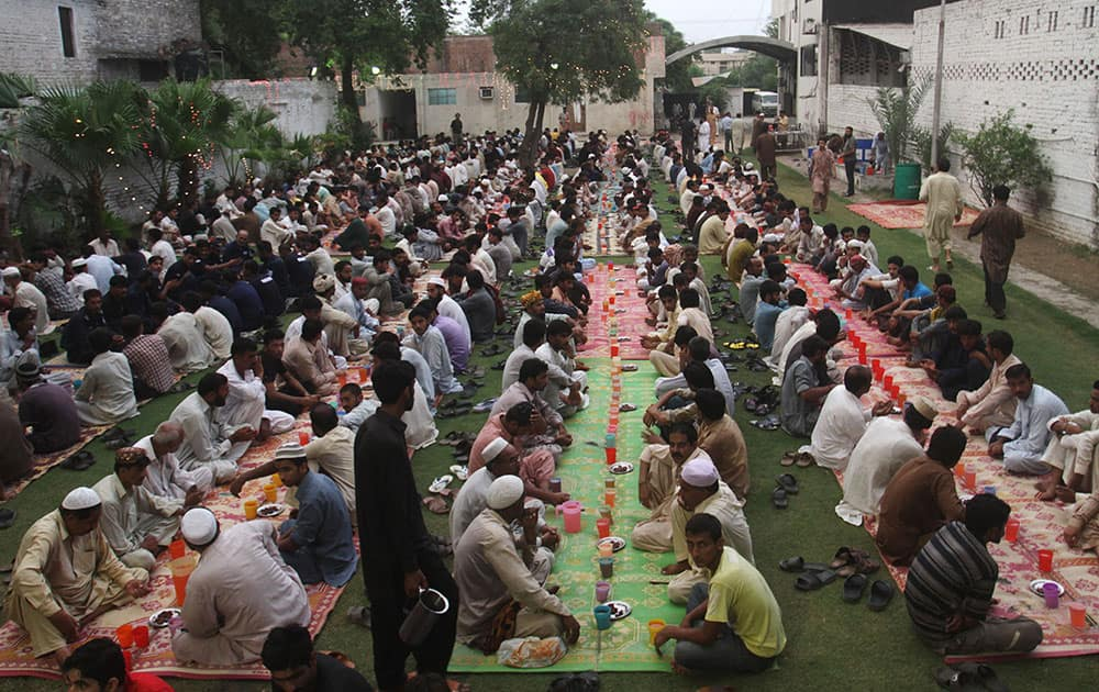 Pakistani Muslims wait to break their fast at sunset, during the Muslim holy month of Ramadan in Lahore, Pakistan.