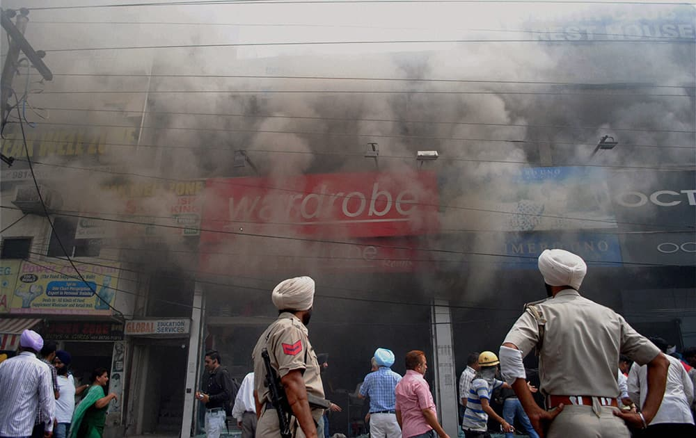 Smoke billowing out of shops where a fire broke out in Amritsar.