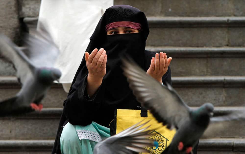 A Kashmiri woman prays outside the shrine of Shah-e-Hamdan during the holy month of Ramadan in Srinagar.