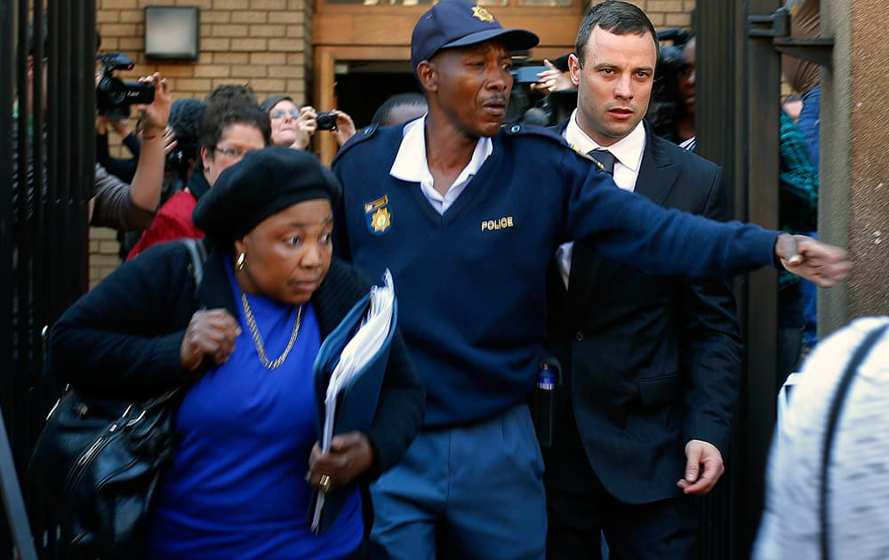 Oscar Pistorius leaves court in Pretoria, South Africa. The murder trial resumed Monday, June 30, 2014 after one month during which mental health experts evaluated the athlete and determined he did not have an anxiety disorder that could have influenced his actions on the night he killed his girlfriend Reeva Steenkamp.
