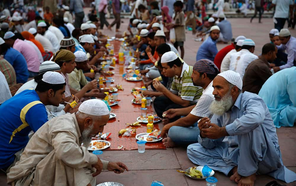 Muslims break fast on the first day of the holy month of Ramadan at the Jama Mosque in New Delhi.