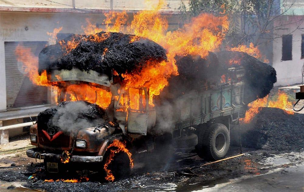 A truck in flames in Beawar, Rajasthan.