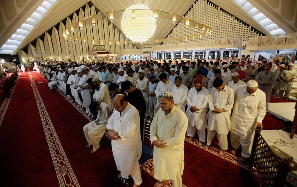 Pakistan Muslims offer an evening prayer called `tarawih` marking the first eve of the holy fasting month of Ramadan, at Grand Faisal Mosque in Islamabad, Pakistan.