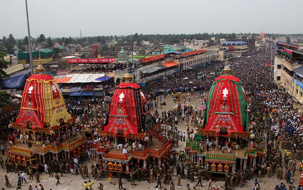 Devotees gather near chariots as they prepare to pull them during the annual Hindu festival 'Rath Yatra' or chariot procession in Puri, Orissa state.