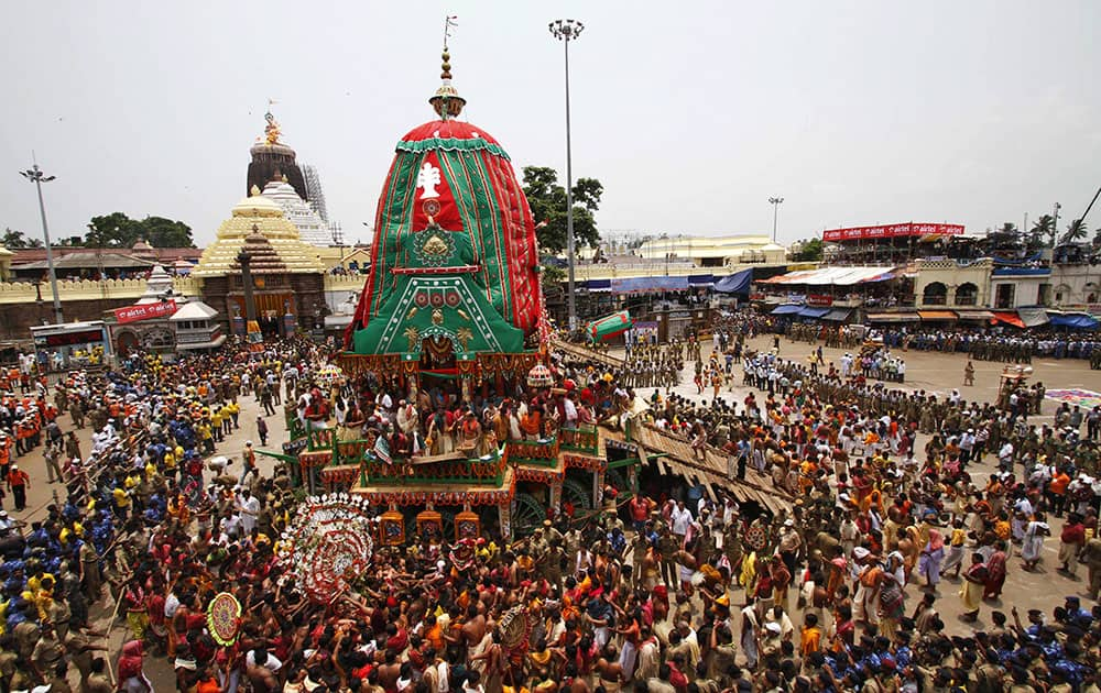 Devotees gather around the chariot of Lord Balabhadra during the annual Hindu festival 'Rath Yatra' or chariot procession in Puri, Orissa state.