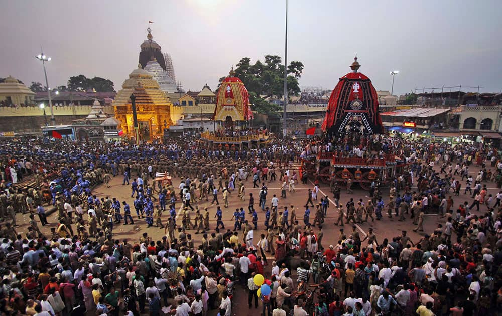 Devotees and paramilitary forces pull chariots to set in front of the Lord Jagannath temple, on the eve of the annual Rath Yatra, or Chariot procession, at Puri, 65 kilometers (40 miles) away from the eastern Indian city of Bhubaneswar.