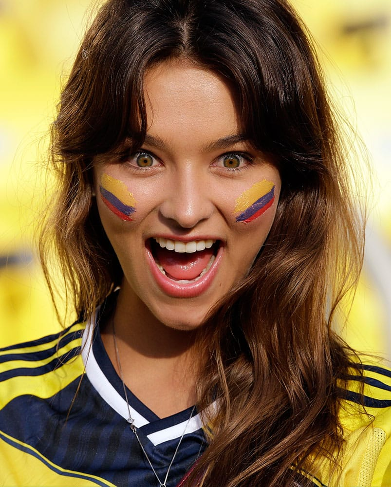 A fan of Colombia cheers prior to the World Cup round of 16 soccer match between Colombia and Uruguay at the Maracana Stadium in Rio de Janeiro, Brazil.
