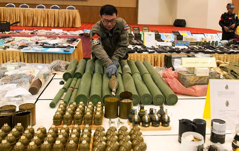 Thai police officers display rocket propelled grenades they seized during raids from May 22 to June 25 at a news conference in Bangkok, Thailand.
