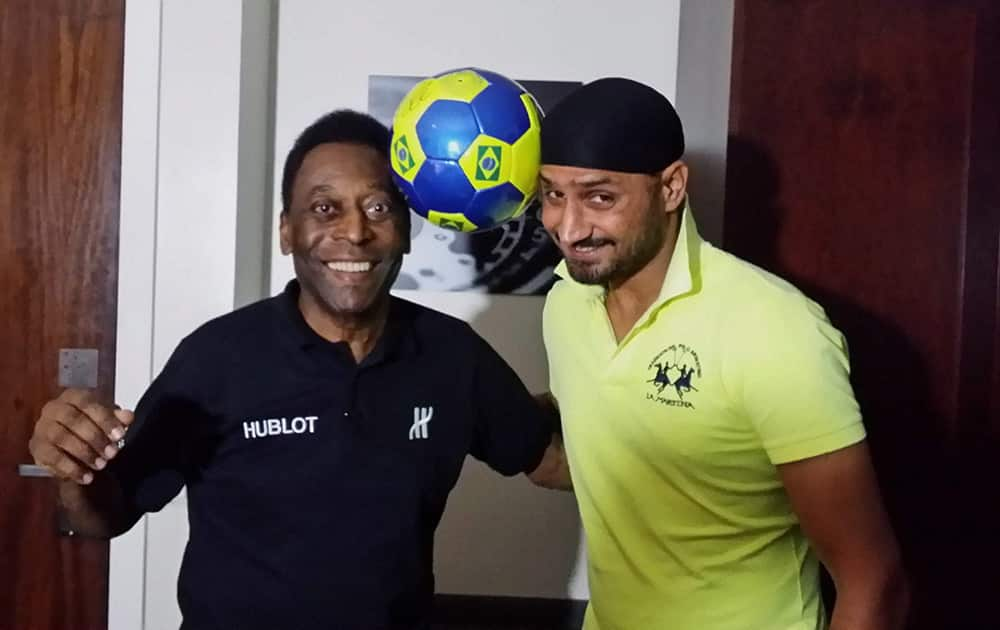 Harbhajan Singh, who is in Brazil to watch the FIFA World Cup, shares a light moment with the legendary Brazilian footballer Pele in Rio de Janeiro.