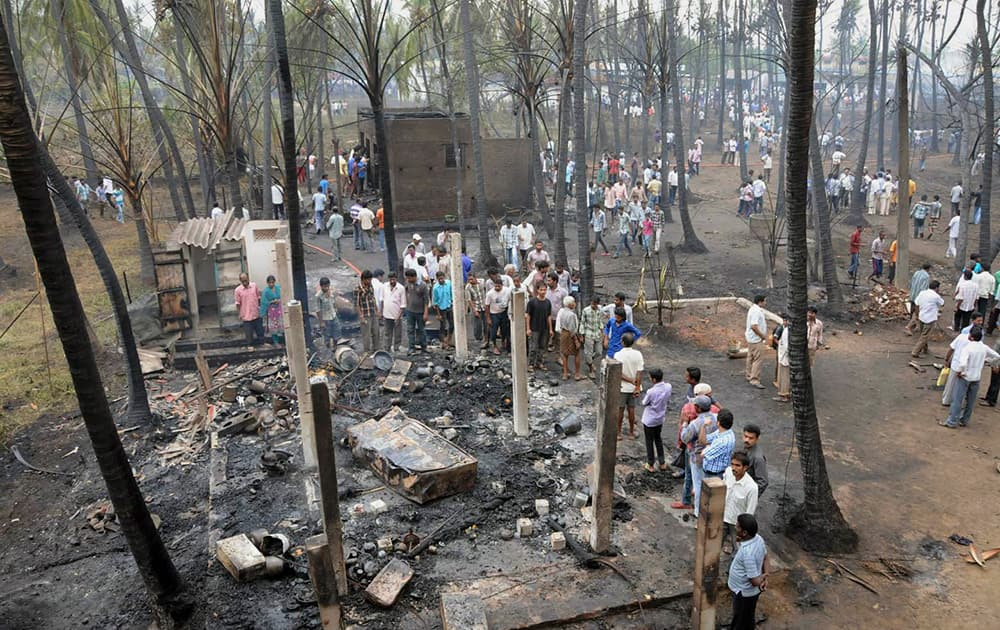 People gather at the site of a pipeline explosion in Nagaram village near Rajahmundry in East Godavari district.