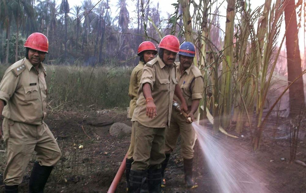 Fire men dousing at gas pipeline fire in Nagaram village near Rajahmundry in East Godavari district.