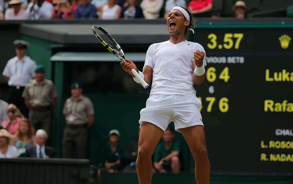 Rafael Nadal of Spain celebrates as he defeated Lukas Rosol of Czech Republic in their men`s singles match on Centre Court at the All England Lawn Tennis Championships in Wimbledon, London.