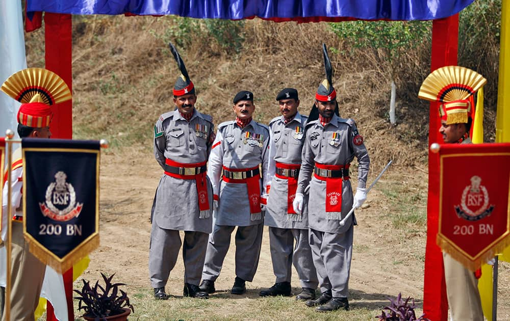 Pakistani rangers stand guard during the annual Chamliyal fair at Chamliyal post, about 47 kilometers south of Jammu. The over 300-year old festival is celebrated on the fourth Thursday every June at two spots, one at Chamliyal in the Indian territory and the other at Saidanwali in Pakistan in honor of the saint.