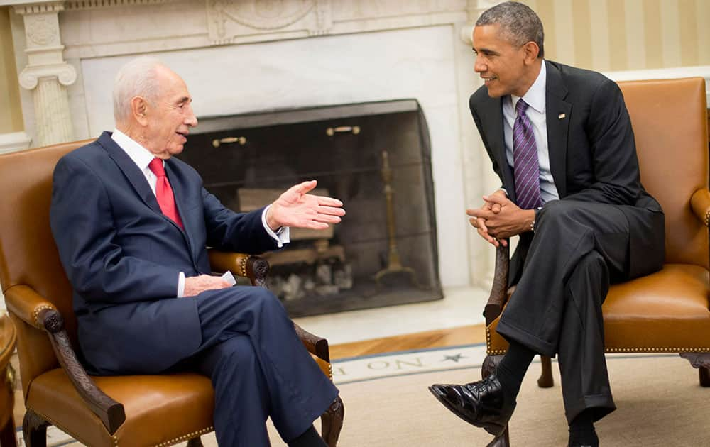President Barack Obama meets with Israeli President Shimon Peres, in the Oval Office of the White House in Washington.