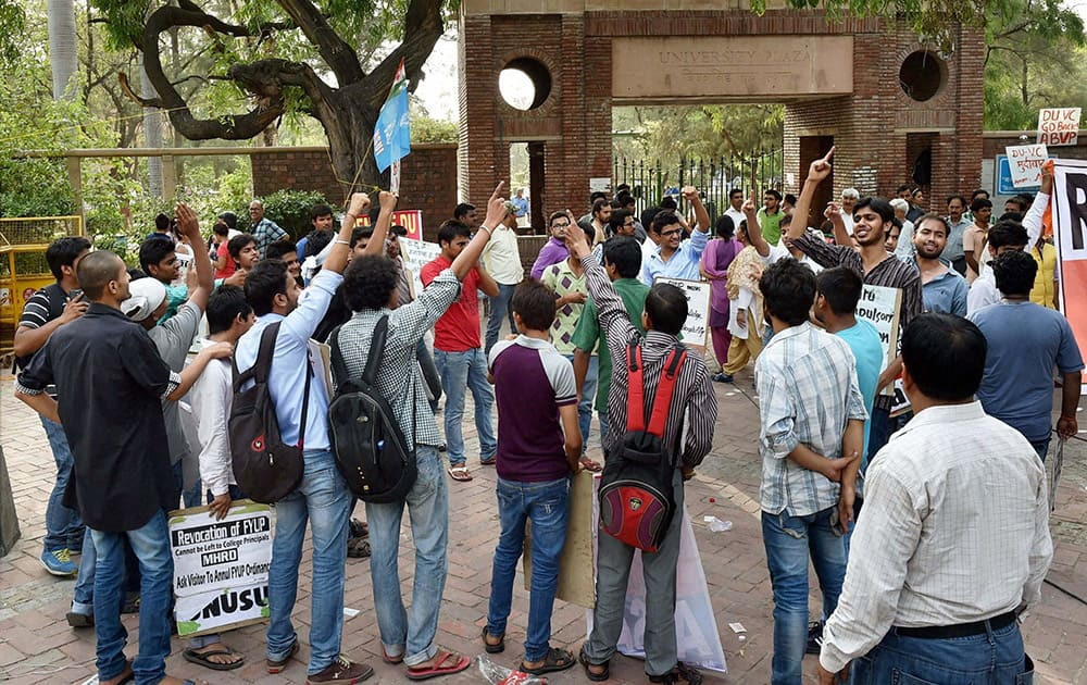 AISA activists shout slogans during a protest over controversial FYUP at Delhi University campus.