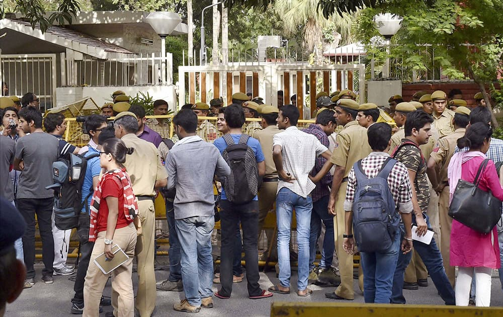 Media and security outside the residence of Delhi University VC Dinesh Singh in New Delhi.