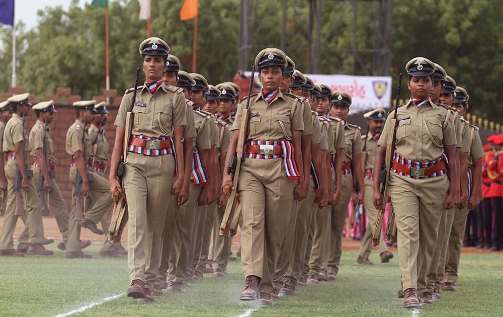 Indian women police officers march during their passing out parade at Gujarat Police Academy near Gandhinagar.
