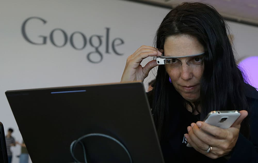Cecilia Abadie, founder of 33 Labs, uses a pair of Google Glass as she registers for Google I/O 2014 at the Moscone Center in San Francisco.