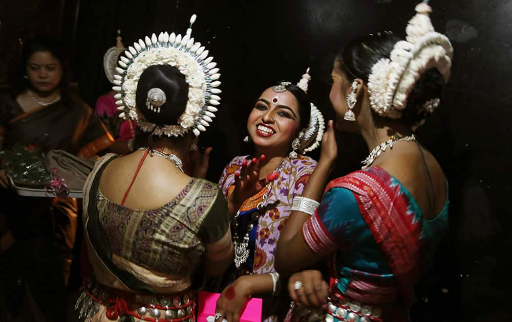 Dancers share a light moment backstage before performing during a classical dance festival in Bangalore.