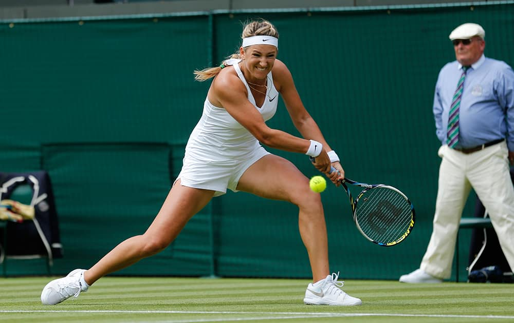 Victoria Azarenka of Belarus returns against Mirjana Lucic-Baroni of Croatia during their first round match at the All England Lawn Tennis Championships in Wimbledon, London.