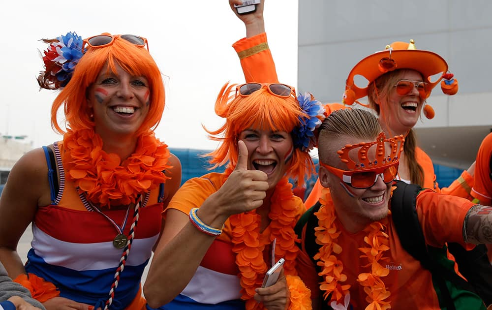 Dutch fans cheers for their national before the group B World Cup soccer match between the Netherlands and Chile at the Itaquerao Stadium in Sao Paulo, Brazil.