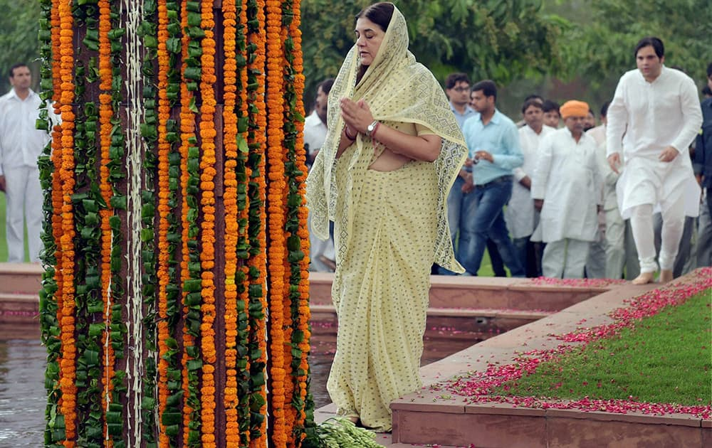 Women and Child Welfare Minister Maneka Gandhi with her son & BJP MP Varun Gandhi pay tribute to her husband Sanjay Gandhi on his death anniversary at his memorial in New Delhi.