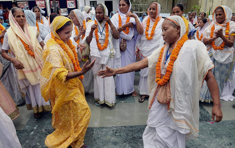 Widows from Virandavan perform a dance as they take part in an event to mark International Widows` Day in New Delhi.