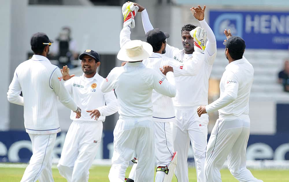 Sri Lanka`s captain Angelo Mathews, second right, celebrates with teammates after England`s Stuart Broad was caught by Lahiru Thirimanne for 4 runs, during day three of the Second Test Match between England and Sri Lanka at Headingley cricket ground, Leeds, England.