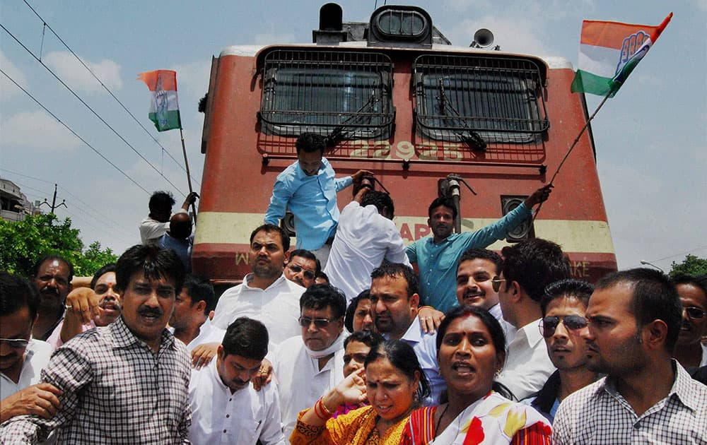 Congress activists block a train passage while protesting against hike in the Railway fares in Bhopal.