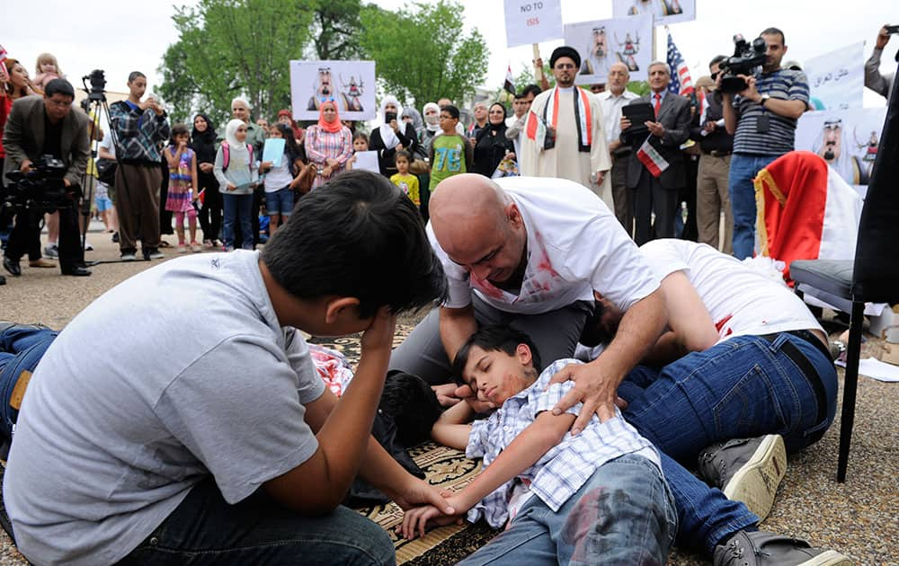 Members of an Iraqi youth theater group perform part of their play `Broken Dreams` on Pennsyllvania Ave., outside the White House in Washington.
