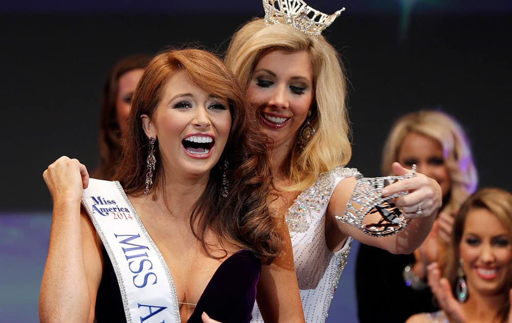 Ashton Campbell, left, celebrates being named Miss Arkansas with last year`s winner Amy Crain at the Miss Arkansas Pageant in Hot Springs, Ark.