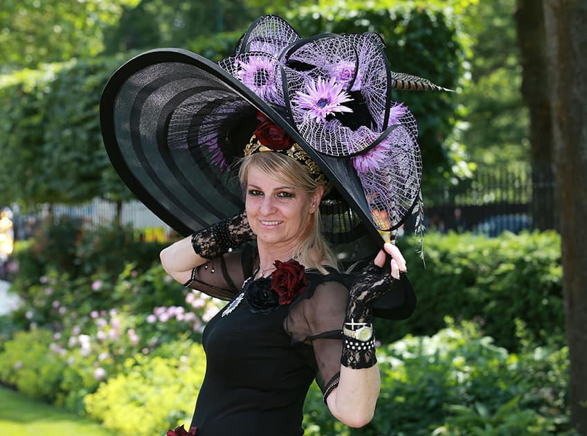 A spectator models an ornate hat on day five of the 2014 Royal Ascot Meeting at Ascot Racecourse, Berkshire, England.