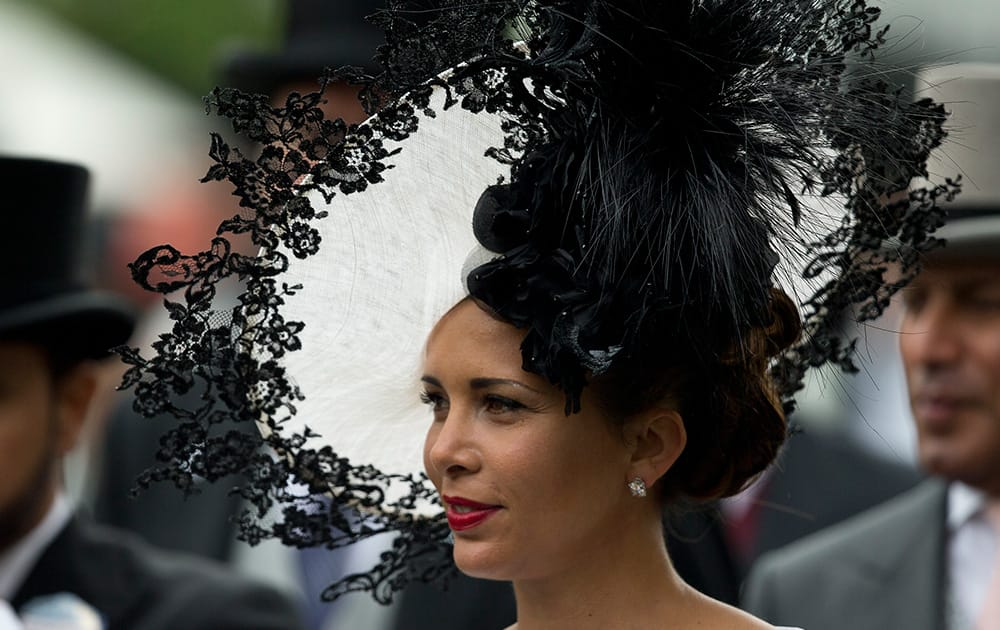 Princess Haya of Jordan wears an ornate hat in the parade ring on the third day of the Royal Ascot horse racing meeting, which is traditionally known as Ladies Day, at Ascot, England.