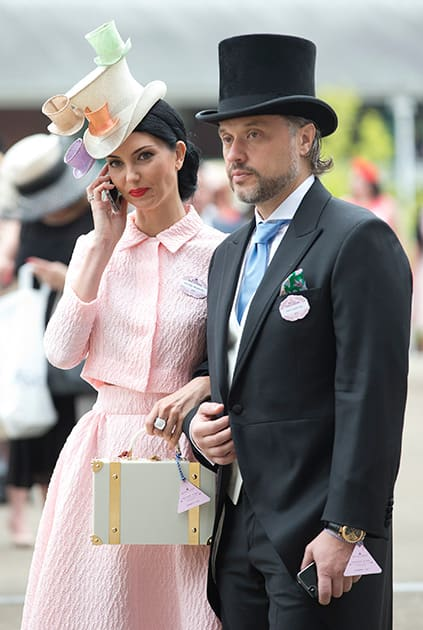 Olga Stepanenko and Valerii Lapter walk in the parade ring on the third day of the Royal Ascot horse racing meeting, which is traditionally known as Ladies Day, at Ascot, England.