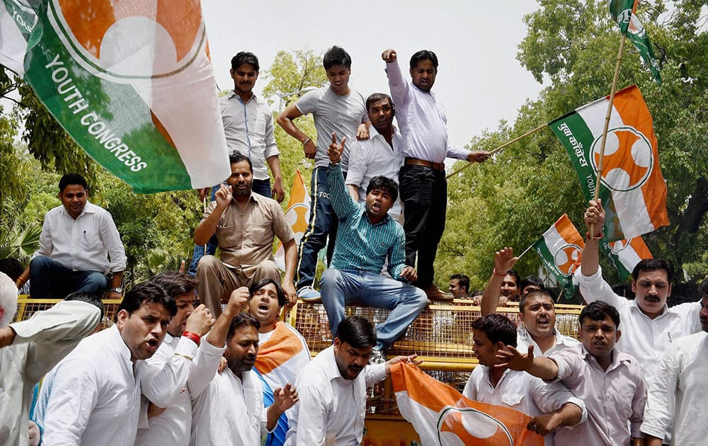 Youth Congress activists shout slogans during a protest against proposed rail fare hike, in New Delhi.