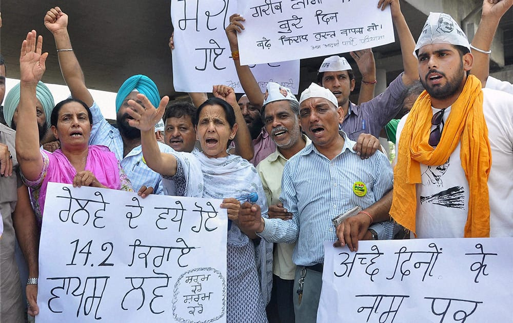 AAP volunteers shout slogans during a protest against proposed rail fare hike, in Patiala.