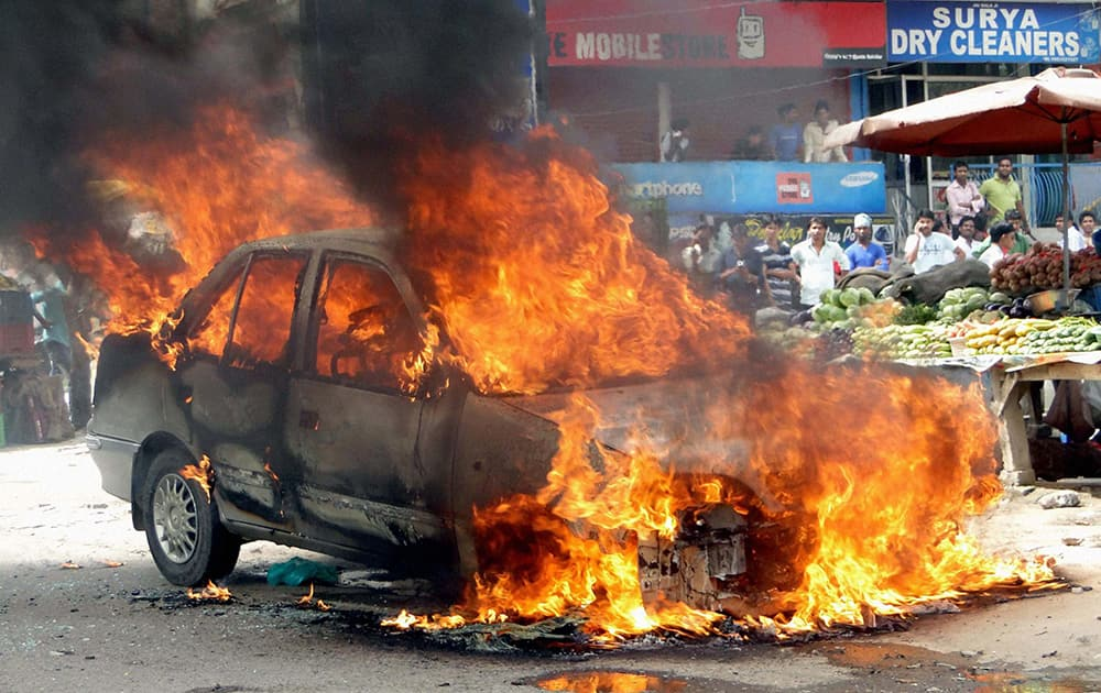 A car catches fire in Vasundhra in Ghaziabad.