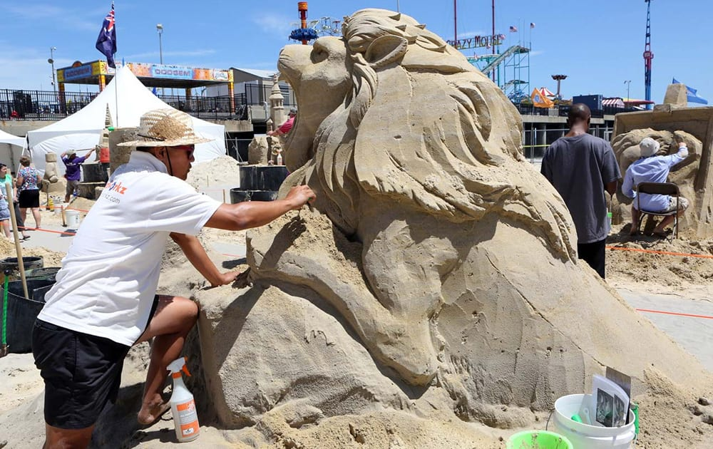Jooheng Tan, of Singapore, works on his sand creation during the DO AC Sand Sculpting World Cup singles event on the beach in Atlantic City, N.J.