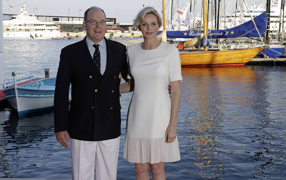 Prince Albert II of Monaco, left, and his wife Princess Charlene pose, during the inauguration of the Yacht Club de Monaco's new building.