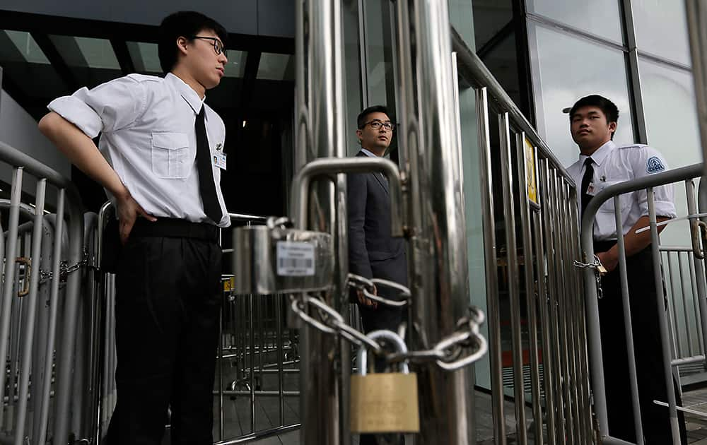 Security personals stand guard outside Legislative building in Hong Kong. Security stepped up after protesters, last Friday, against the government on a development plan in the North Eastern New Territories, storming at the Legco building with bamboo poles and smashed glass panels last Friday, police have arrested 24 people.